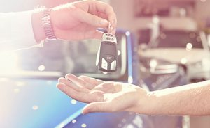 Big image of handing car keys.